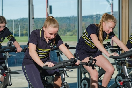 Students on Stationary Bikes